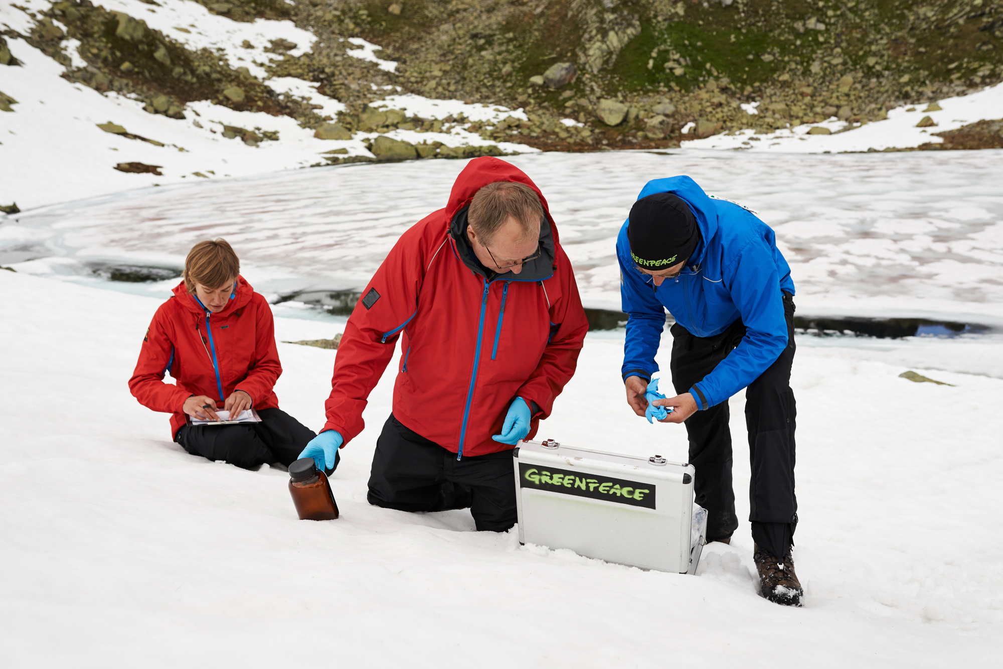 Greenpeace scientists collect water and snow samples to test for PFCs.