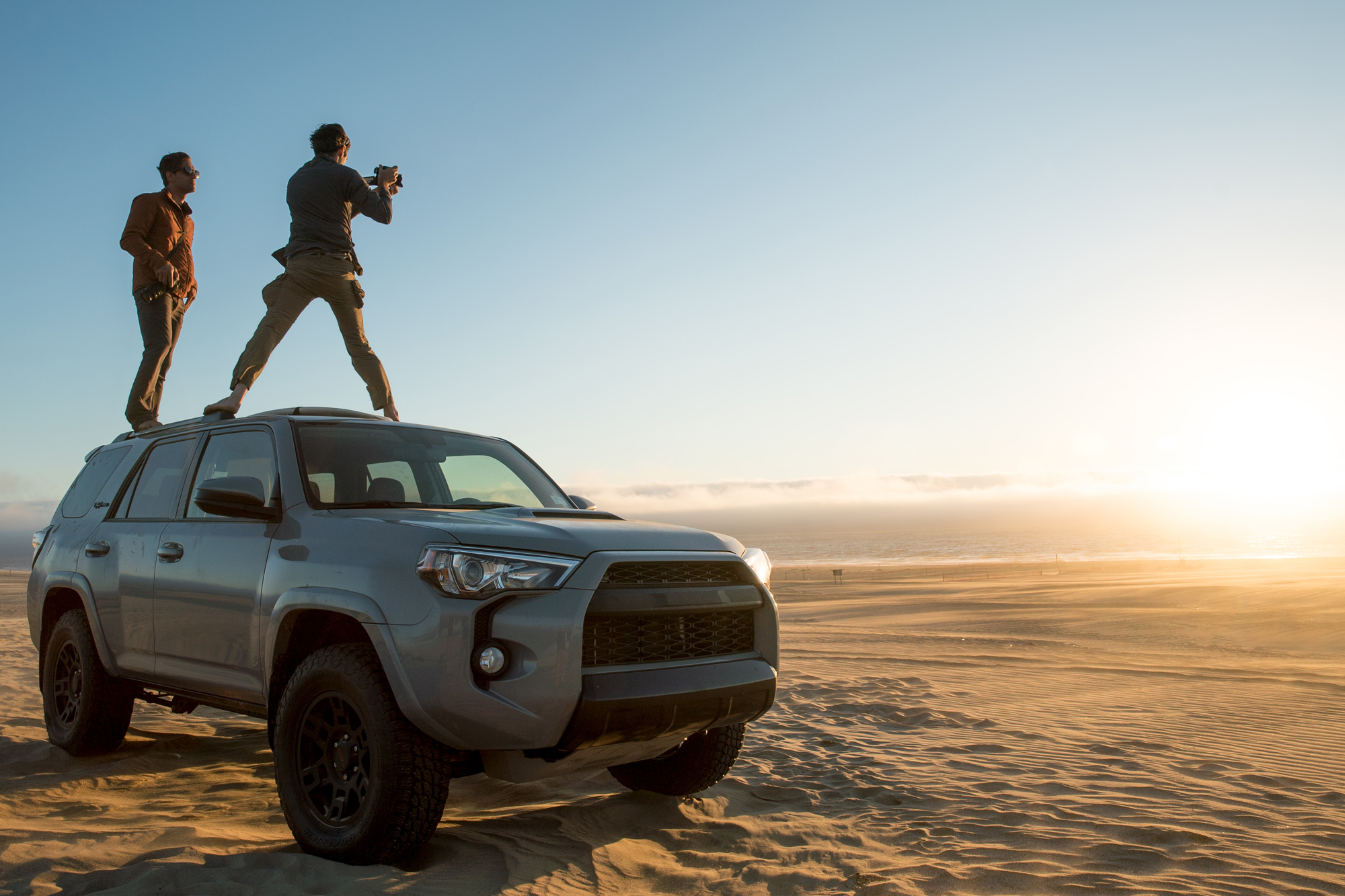 Standing on vehicle filming in Australian desert