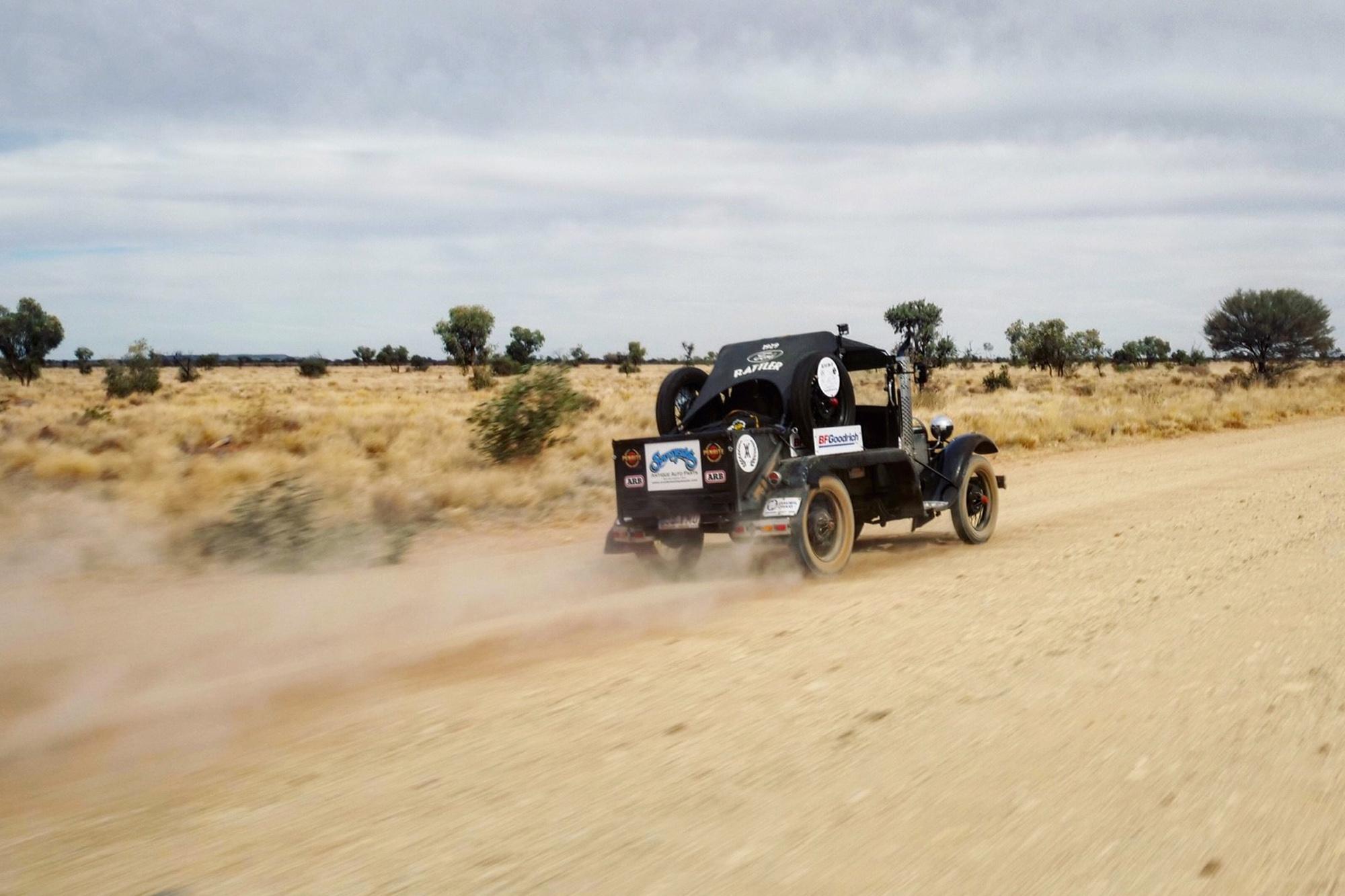 Vehicle speeding along dirt road in Australia
